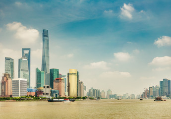 Scenic view on Shanghai, China. Beautiful daytime skyline with skyscrapers and the Hunapu river.
