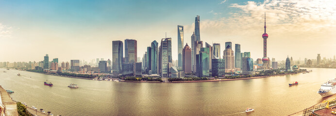 Aerial panorama view on Shanghai, China. Beautiful daytime skyline with skyscrapers and the Hunapu river.