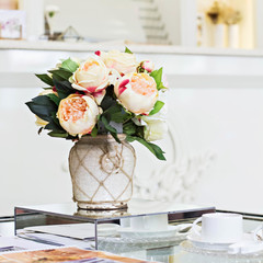 Beautiful bouquet of peonies in a vase.