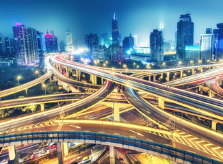 Tuinposter Aziatische Plekken Scenic view on famous highway interchange in Shanghai, China at night. Multicolored nighttime skyline.