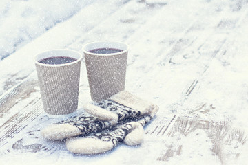 paper craft glass,  cup  with a hot drink, coffee, cocoa, mulled wine and white and black mittens