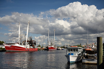 Colorful Gulf Coast waterway with fishing boats, blue sky and clouds in Florida / USA.