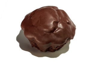 Single chocolate black cupcake coated in chocolate isolated on white background from above