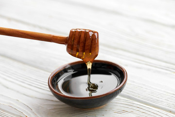 honey on a white wooden Board