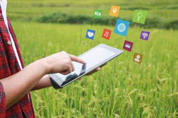 Smart farming,hand farmer presses on screen digital smartphone,social media concept,selective focus,