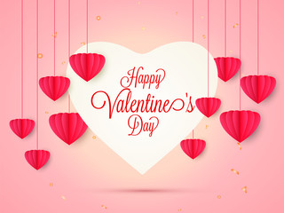 Happy Valentine's Day greeting card design decorated with red paper origami hearts hang on shiny pink background.