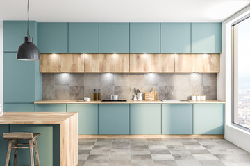 Green kitchen with counters and bar