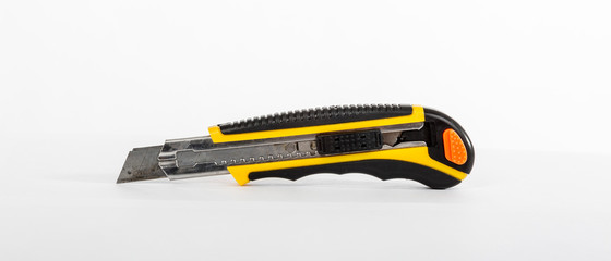 Construction knife yellow and black Fotomurales