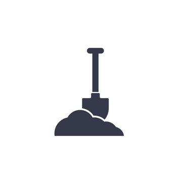 Shovel in dirt vector icon on white