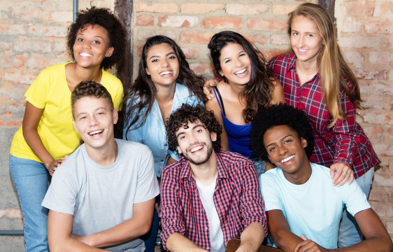 Portrait of group of latin and african american young adult people