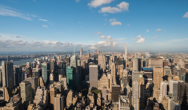 Aerial View of Upper Manhattan on a clear sunny day, Central Park visible in the distance