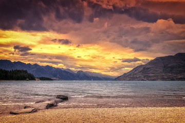 the Lake Te Anau in New Zealand at sunset