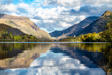 Reflections at Llyn Padarn with Dolbadarn Castle at Llanberis in Snowdonia National Park in background - Wales Wall mural