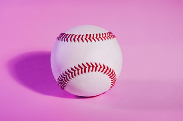 baseball on a Pink color background and red stitching baseball. copy space.