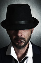 Retro man with the hat and cigarette