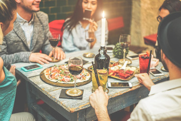 Group of friends drinking appetizer in vintage american bar