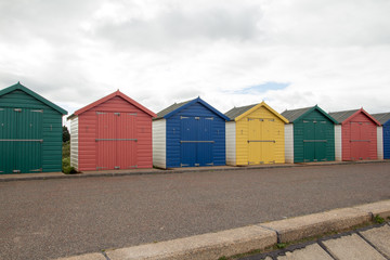 Seaside beach huts on a cloudy day