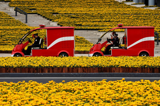 Firemen drive electric firetrucks at the National Exhibition and Convention Center, the venue for the upcoming China International Import Expo (CIIE), in Shanghai