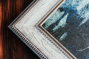 Detail of picture in wooden frame.