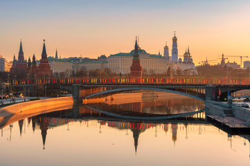 Moscow skyline at sunrise with Kremlin reflection on Moscow river. Kremlin with Kremlin Wall and towers. Moscow Russia.