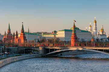 Moscow Kremlin at sunset with Moscow river, Kremlin Wall, towers and Grand Kremlin Palace. Moscow Russia.