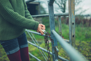 Young woman holding padlock