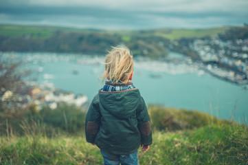 Toddler looking at seaside town