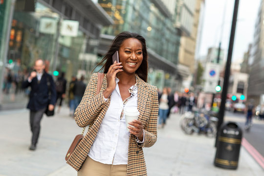 Young happy  business woman talking on the phone