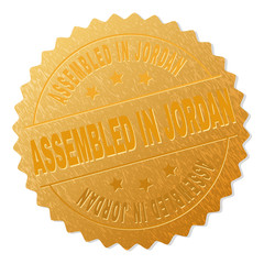 ASSEMBLED IN JORDAN gold stamp award. Vector golden medal with ASSEMBLED IN JORDAN text. Text labels are placed between parallel lines and on circle. Golden area has metallic structure.