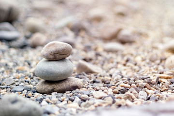 Pile of stones with sunlight in japanese zen garden, copy space, close-up