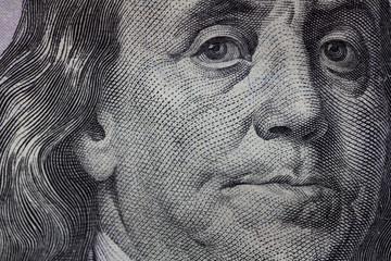 Benjamin Franklin portrait macro usa hundered dollar banknote or bill.