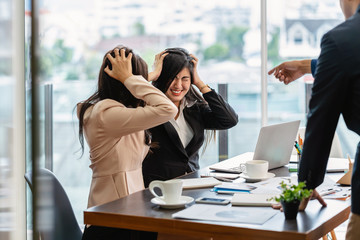 Scene of Furious boss scolding asian young couple businesswoman in formal suit by point to her face in modern office, Business mistake and punish concept