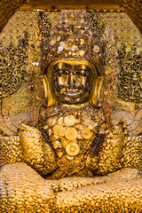 the golden buddha of Maha Myat Muni Pagoda temple Mandalay city Myanmar (Burma)