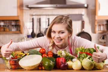 Woman having vegetables on table