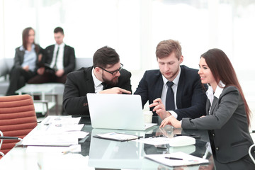 employees of the company discussing with the client the terms of the contract