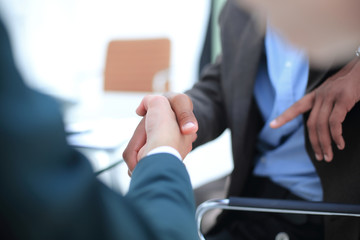 background image handshake trading partners .the business concept.