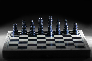 black chess pieces on the game Board.strategy concept
