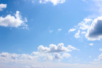 Small white clouds formation over clear blue sky