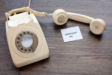 Retro telephone with note - Contact Us