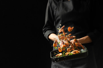 Professional chef cooked shrimp. Culinary seafood and food on a dark background. Photo of the hotel. Horizontal view. Fototapete