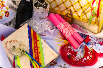 Wedding items, composition of festive paraphernalia for the wedding. Colorful scenery in nature, photo for memory. Represents tenderness and romance of the celebration.