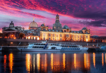 Impressive sunset on Elbe river Scenic sunset view of ancient buildings and street architecture in the Old Town with colorful clouds under sunlit. Famouse Dresden, Bavaria, Germany Wall mural