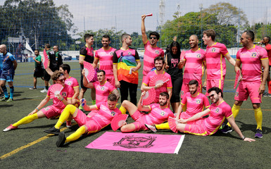 Soccer players of the Futeboys soccer team poses for a photo during opening ceremony of the Champions LiGay, gay soccer tournament in Sao Paulo