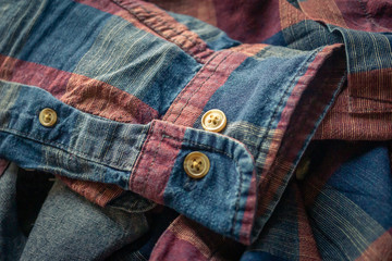details of red and blue checkered shirt