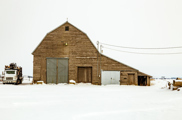 Antique barn in rural Quebec Canada after a snow storm.