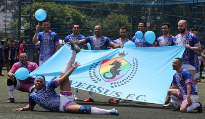 Soccer players of the Diversus soccer team pose for a photo during the Champions LiGay, a gay soccer tournament in Sao Paulo