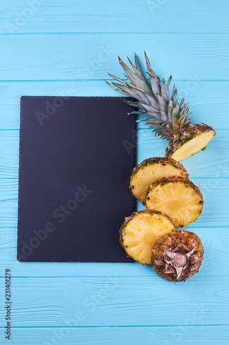 Composition From Fresh Pineapple On Wooden Background Cutted