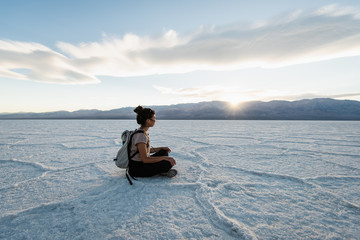 Meditating on the salt flats in Death Valley at sunset