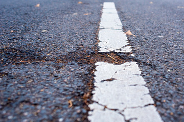 pothole and white street line