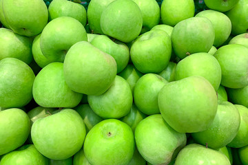Pile of green apples in supermarket